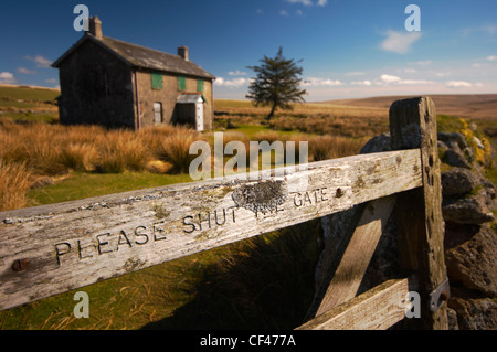 Nun's Cross farmhouse on Dartmoor, abandoned in the 1950's but now used as accommodation for outward bound training. - Stock Photo