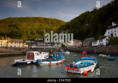 Fishing boats bobbing around in Lynmouth harbour on the North Devon coast. - Stock Photo
