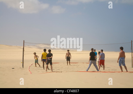 Rabil Boa Vista Cape Verde Islands Group of people playing volleyball on pristine unspoilt beach of Areja de Chaves - Stock Photo
