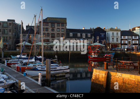 Fishing trawlers and yachts in the harbour at Plymouth's historic Barbican at dawn. - Stock Photo