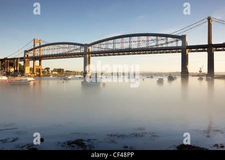 Dawn mist on the River Tamar below The Royal Albert Bridge and Tamar Bridge at Plymouth. - Stock Photo