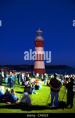 A crowd gathered by Smeaton's Tower on Plymouth Hoe for the National Firework championships 2010. - Stock Photo