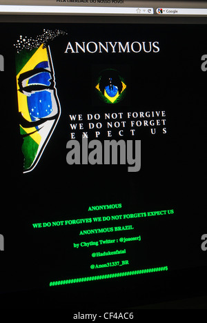 Message screen on a website hacked into by worldwide hacktivist group Anonymous - Stock Photo