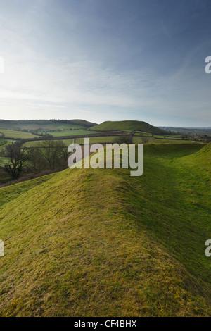 Ramparts on Cadbury Castle hill fort looking towards Parrock Hill. Somerset. England. UK. - Stock Photo