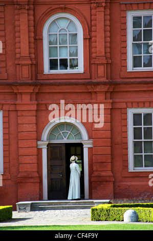 Maid at the entrance of the Kew Palace in Royal Botanic Gardens, Kew - Stock Photo