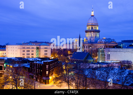 The Illinois State capital building looms over downtown Springfield, IL on a cold winter evening. - Stock Photo