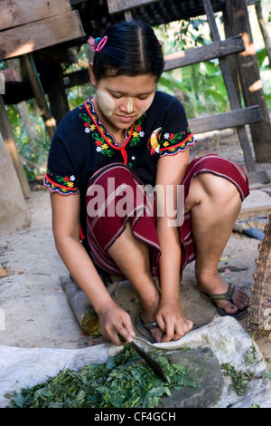 A Karen refugee woman from Burma, (Myanmar) is wearing traditional hilltribe clothing in Ban Tha Ta Fang, Thailand. - Stock Photo