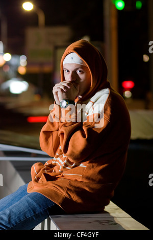 Fashionable young guy posing outdoors in the city - Stock Photo