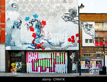 Street Art on buildings in Curtain Road in the east end of London. - Stock Photo