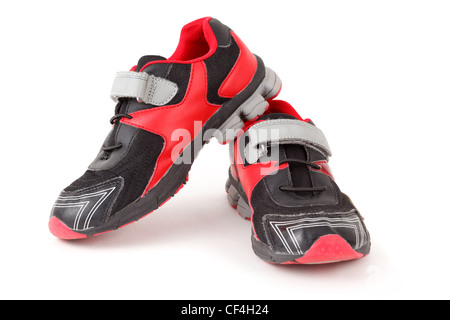 Pair of sports shoes, black and red colors on white background. Isolated. - Stock Photo
