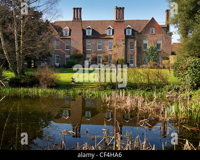 The rear of Hintlesham Hall, a stunning 16th century Elizabethan Grade I listed country house hotel, reflected in - Stock Photo