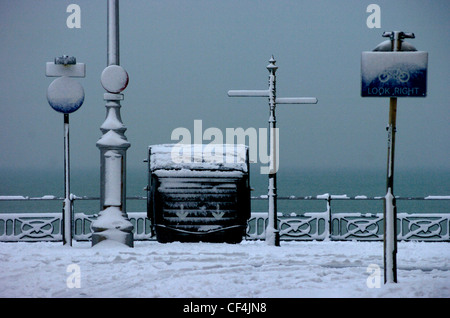 Signposts obscured by snow on the seafront at Brighton. - Stock Photo