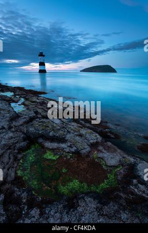 Penmon lighthouse and Puffin Island at Penmon Point on the Isle of Anglesey. - Stock Photo