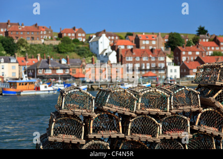 Lobster pots stacked up by the harbour in Whitby. - Stock Photo