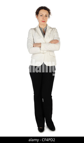 young beauty brunette woman in business dress, standing with crossed hands, full body, isolated on white - Stock Photo