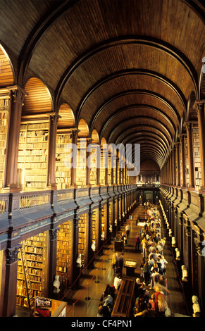 The Long Room in Trinity College Library, Dublin. The library is the largest in Ireland and is the only Irish library - Stock Photo