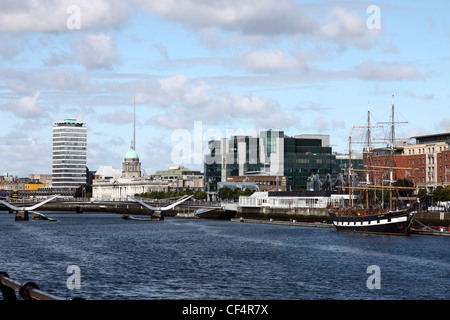 View along the River Liffey towards Custom House Quay from the South Quays featuring Liberty Hall, Customs House, - Stock Photo