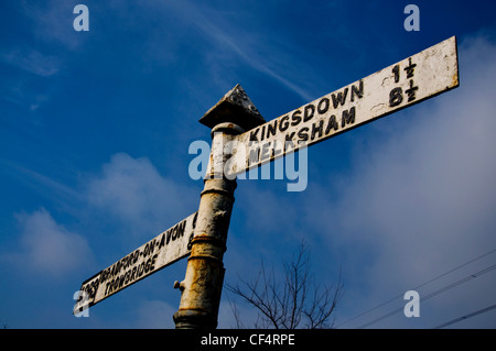 Old iron roadsign on A363 - Stock Photo