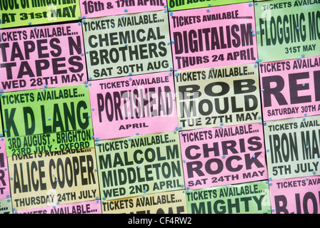 Cards pinned to a board advertising concert tickets in a London West End ticket outlet. - Stock Photo