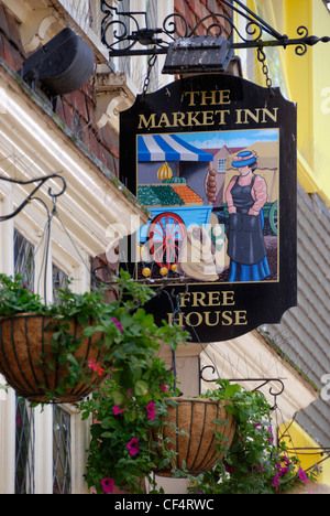An inn sign hanging outside The Market Inn Free House in Butcher Row. - Stock Photo