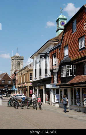 Bicycles chained to bike stands in the pedestrianised high street in Salisbury. - Stock Photo