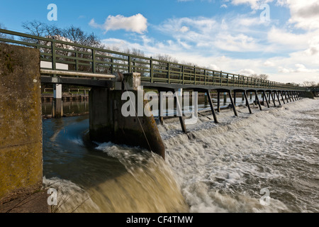 Sluice gate in the weir at Teddington Lock, the upstream limit of the tide on the River Thames. - Stock Photo