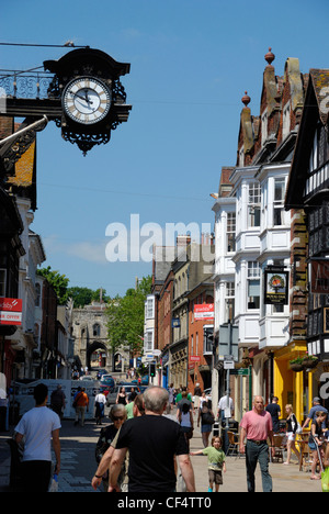 People walking along the High Street in the historic city of Winchester. - Stock Photo