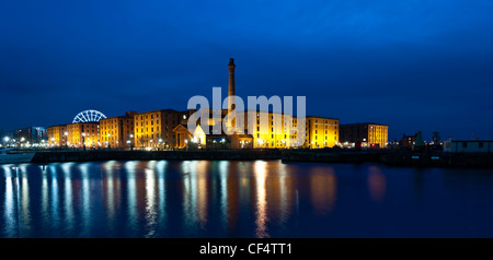 Albert Dock buildings at night with reflections in the waters of Canning Dock. The Albert Dock complex was the world's - Stock Photo