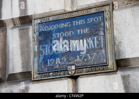 Blue plaque marking the location of the former Stocks Market in the City of London. - Stock Photo