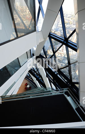 Internal view looking down the atrium at 30 St Mary Axe, known as the Gherkin. - Stock Photo