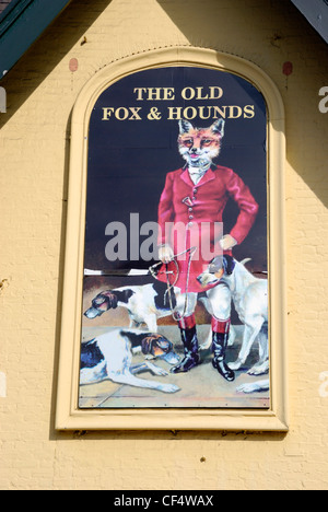 A pub sign on a wall outside The Old Fox and Hounds pub in Croydon. - Stock Photo