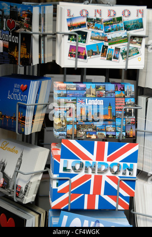 London postcards for sale in a stand outside a souvenir shop. - Stock Photo