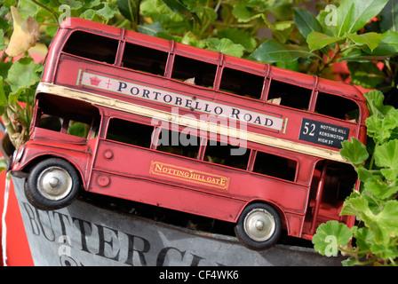 Model replica of a red London routemaster double-decker bus in a Portobello Road antiques shop. - Stock Photo