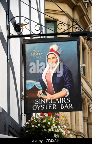 A sign for Sinclairs Oyster Bar in Cathedral Gates, Manchester. The pub dates back to 1720. - Stock Photo