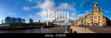 The Sage Gateshead and the Tyne Bridge spanning the River Tyne viewed from the Newcastle quayside. - Stock Photo