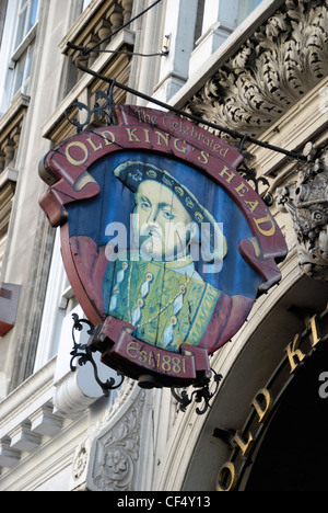 The Old King's Head sign hanging outside the pub in Borough High Street. - Stock Photo