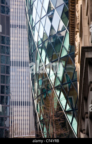 30 St Mary Axe known as the Gherkin in the City of London. - Stock Photo