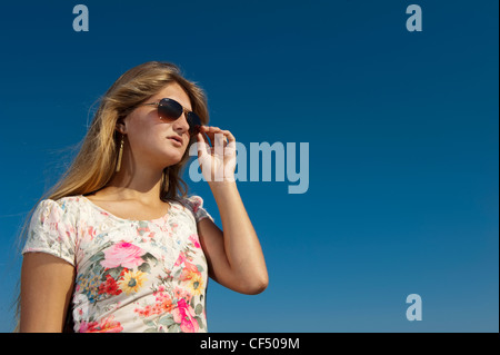 Pretty young woman relaxing on a sunny day in Alcudia, Majorca. - Stock Photo