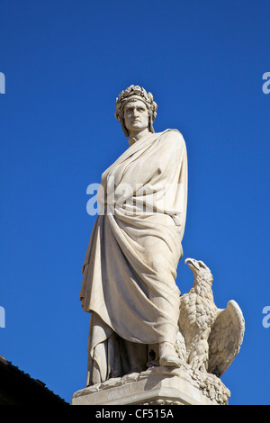Statue of poet Dante Alighieri in front of Santa Croce church in Piazza Santa Croce, Florence, Tuscany, Italy, Europe - Stock Photo