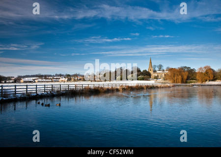 All Saints' Church in a snow covered landscape in Brompton-by-Sawdon. - Stock Photo