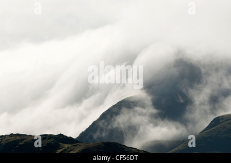The Snowdon massif and clearing clouds - Stock Photo