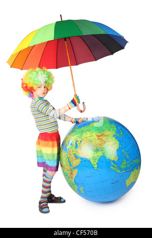 boy in clown dress with umbrella and big globe isolated on white background - Stock Photo