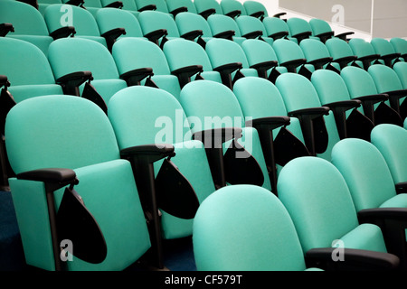 Fragment of empty conference hall, rows of a chairs - Stock Photo