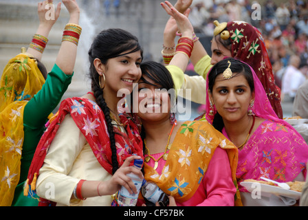 Sikh female dancers in colourful traditional costumes at the 2008 Vaisakhi Sikh New Year Festival. - Stock Photo