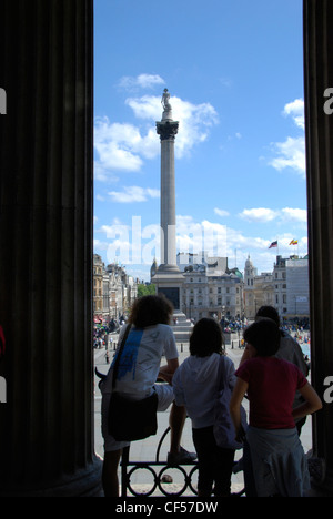 Three tourists admiring the view from the steps of the National Gallery. - Stock Photo