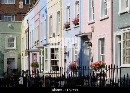 A row of colourful Georgian houses on Bywater Street in Chelsea. - Stock Photo