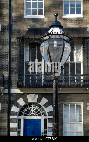 House and old gas lamp in Bedford Square. - Stock Photo