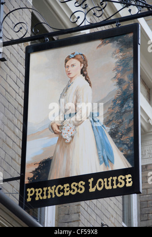 Looking up to the Princess Louise pub sign in Holborn. - Stock Photo