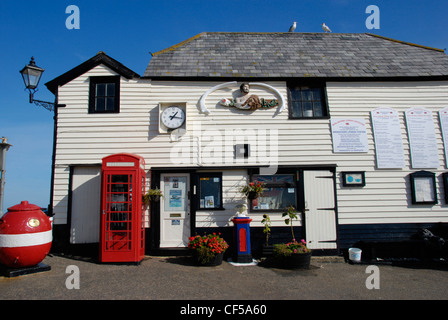 A red telephone booth in front of the Old Lifeboat House in Broadstairs. - Stock Photo