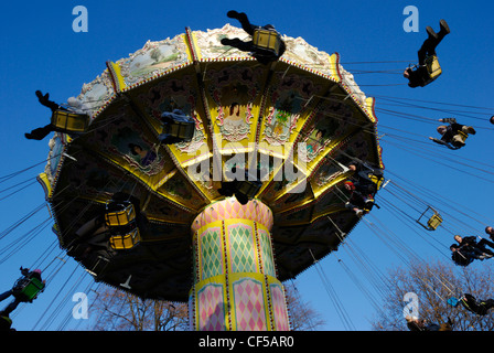 A swing carousel in action at the fairground in Hyde Park. - Stock Photo